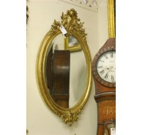 19th century Louis XV oval gilded French mirror with beveled glass