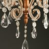 Antique 4 arm iron, wood and crystal Italian chandelier, circa 1880.