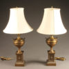 Nice pair of brass urn shaped lamps with silk shades.