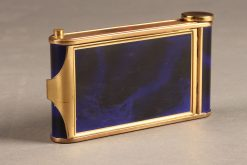 Beautiful ladies compact with lipstick applicator, cigarette case and music box playing the Blue Danube.