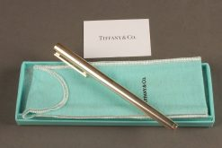 Tiffany & Co. sterling silver pen in original box and felt pouch.