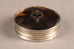 English snuff box made from tortoise shell and sterling silver, circa 1925.