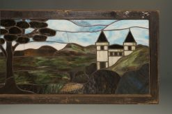 Late 19th century stained and leaded glass panel depicting a castle and trees, circa 1890.