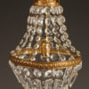 Small single light bronze and crystal French chandelier, circa 1890.