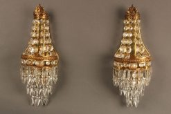Beautiful pair of petite bronze and crystal French sconces.