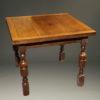 Late 19th century English oak drawleaf pub table, circa 1890-1900.