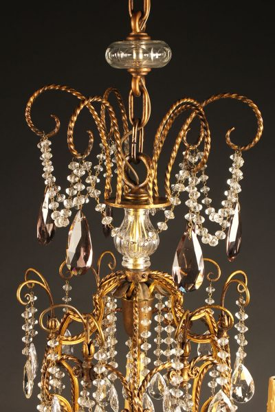 Late 18th century French 12 arm iron and crystal chandelier, circa 1790.
