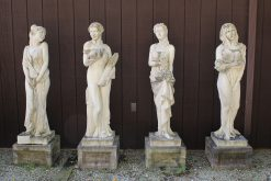 Set of English cast limestone statues representing the four seasons.