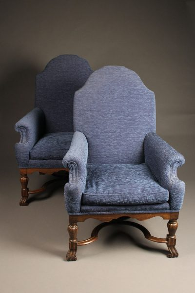 Pair of mid 19th century English arch back armchairs with nicely carved stretcher, circa 1850.