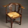 18th century English oak corner chair with rush seat, circa 1760-80.