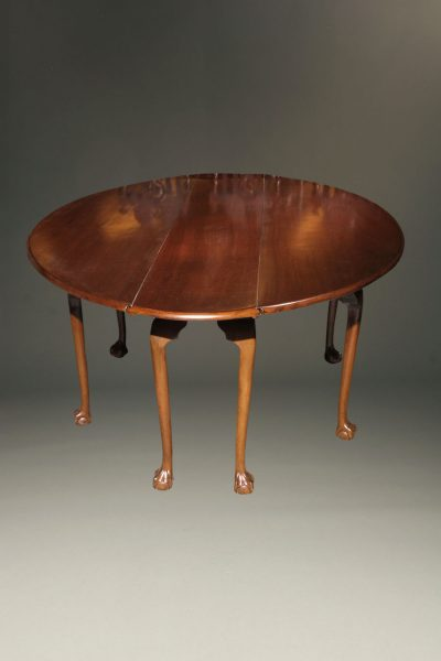 Mahogany Irish wake table with double drop leaves and gatelegs with hand carved ball and claw feet.