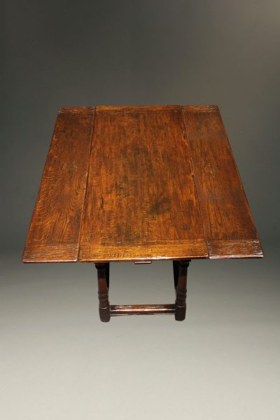 Custom English Jacobean style side draw leaf table in oak.