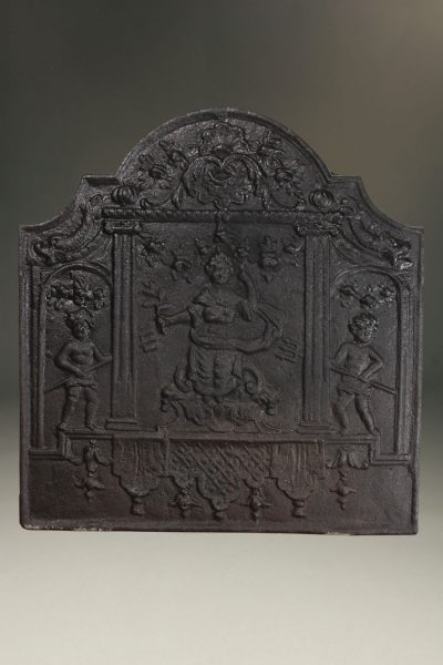 Late 17th century French fireback with a woman and two pitch fork wielding cupids, circa 1680.