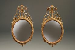 Beautiful pair of oval, Adams style English mirrors with very nice gilded hand carvings, circa 1920's.