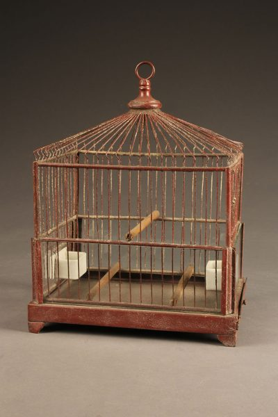 Very nice French finch cage with red painted frame and milk glass water and feeding bowls