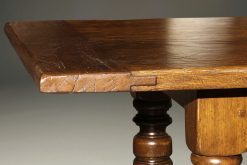 Custom English oak farmhouse table with hand hewn top and turned legs.