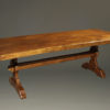 Custom English oak farmhouse table with wood pegged mortise and tenon joinery and hand hewn top.