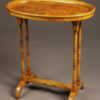 Very nice drinks table with oval top and signed Baker, circa 1920's.