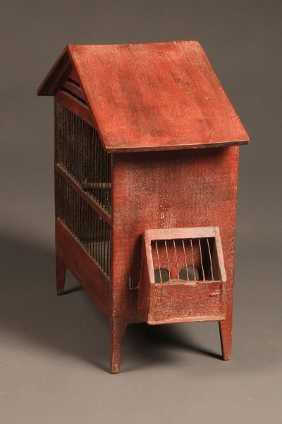 Late 19th century French finch cage with red paint and hand blown glass water bottle