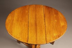 Custom made English oak dropleaf table constructed from 15th century oak timbers salvaged from Norwich cathedral.