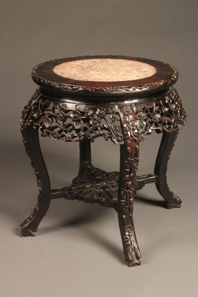 Heavily carved low Chinese table in rosewood with inset marble top
