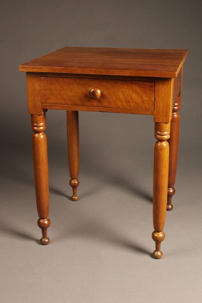 Very nice late 19th century cherry stand table with drawer and turned legs