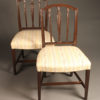 Late 19th century pair of English Hepplewhite side chairs, circa 1890.