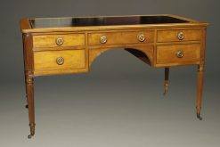 Lovely Kittenger writing desk in solid mahogany with black leather top and brass pulls