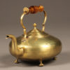 Late 19th century English brass tea pot with amber colored glass handle