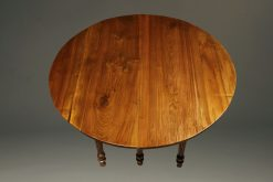 19th century French walnut kitchen table with drop leaves and fluted feet