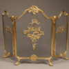 Solid brass folding fireplace screen with ornate castings.