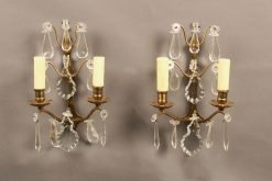 Pair of French 2 arm bronze and crystal sconces.