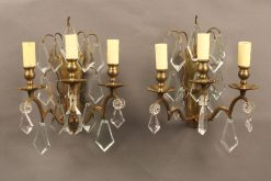 Pair of 3 arm bronze and crystal French sconces.