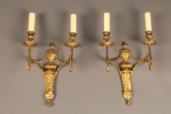 Pair of two arm French Louis XVI style bronze sconces.
