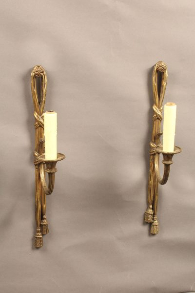 Very nice pair of French single arm bronze sconces.