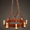 Late 19th century massive country French iron chandelier with 8 arms and reddish finish