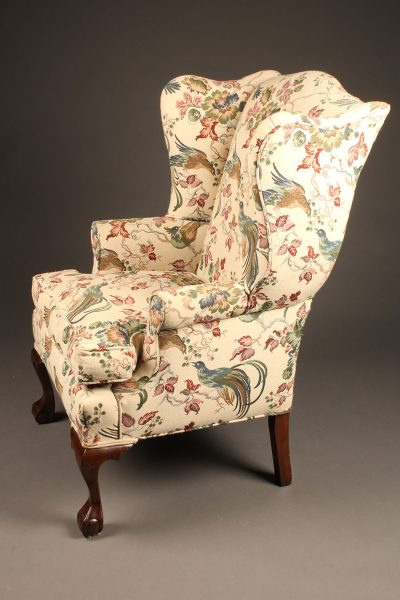 Chippendale style wingback arm chair with cabriole leg and ball and claw feet