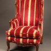 French Louis XV style wingback armchair with down cushion.