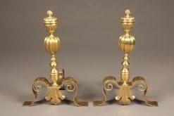 Beautiful pair of cast brass English andirons with fleur de lis