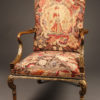 French walnut armchair with ball and claw feet, parcel gilt and handmade tapestry