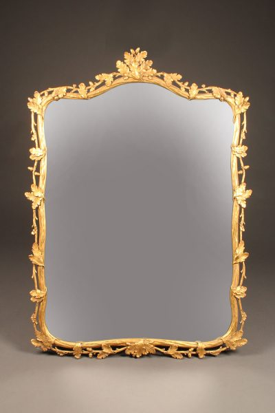 19th century French ornately carved and gilded mirror with oak leaf motif