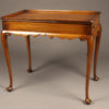 Wonderful mahogany tea table with slides on ends