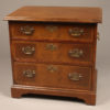 Small Chippendale style mahogany chest of drawers with brass handles on  sides