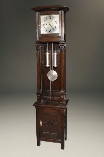 "Oak German tall case clock with ""open well"""