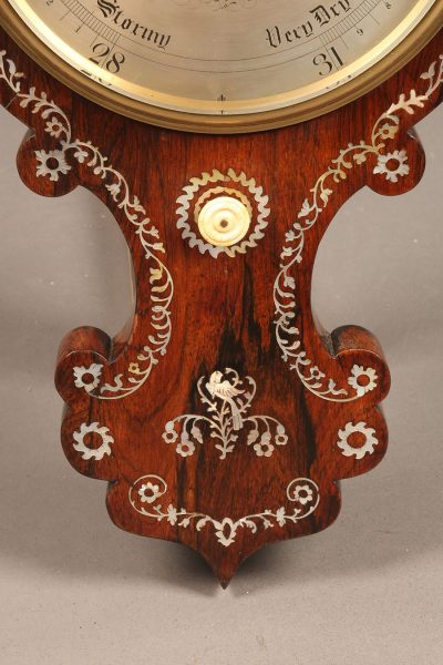 Late 19th century English barometer in rosewood with inlaid mother of pearl