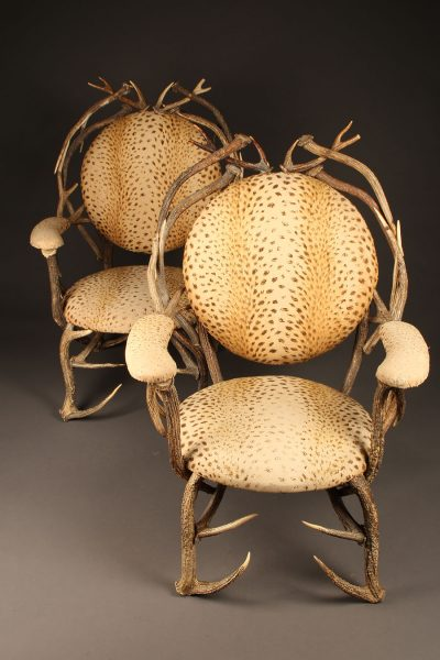 Pair of 19th century French antler chairs with leopard designed upholstery