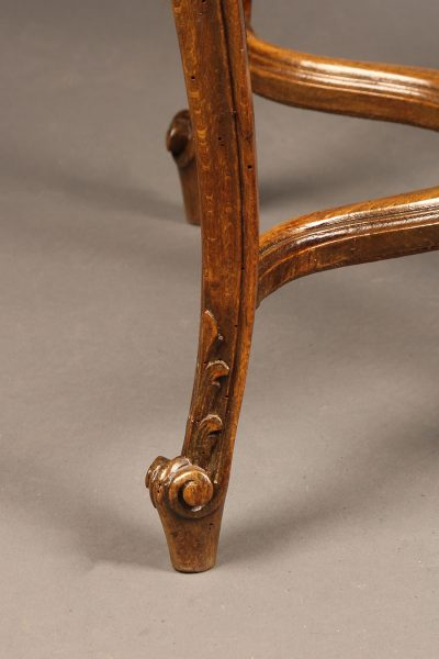 19th century French Louis XV style caned oak stool.
