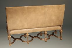 Banquette by Century Furniture company featuring hand carved frame and distressed leather upholstery