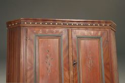 Early 19th century Norwegian pine corner cupboard with original painted finish dated 1825.