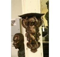 Carved wooden cherub shelf